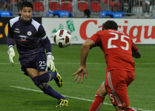 Toronto FC player, Martin Saric, heads the ball past the Cruz Azul goalkeeper
